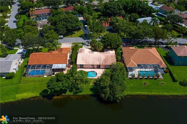 4050 NW 54th Ct, Coconut Creek, FL 33073 (MLS #F10190707) :: The Nolan Group of RE/MAX Associated Realty