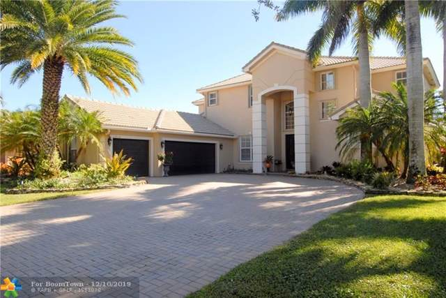 10934 NW 71st Ct, Parkland, FL 33076 (MLS #F10205922) :: Berkshire Hathaway HomeServices EWM Realty