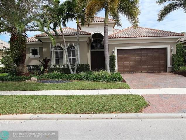 12137 NW 76th Pl, Parkland, FL 33076 (MLS #F10218570) :: Berkshire Hathaway HomeServices EWM Realty