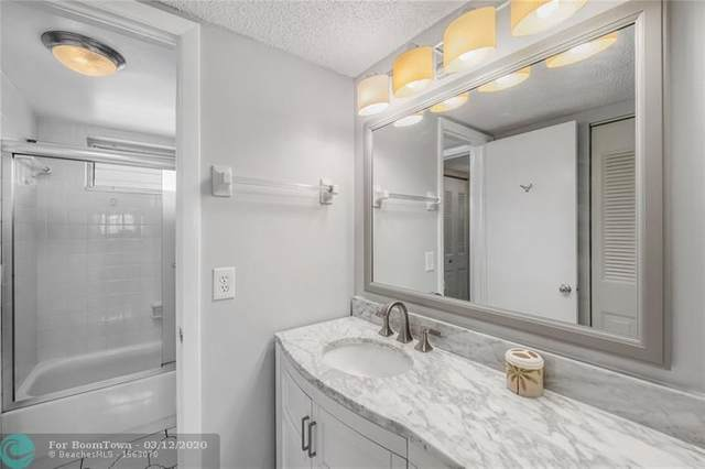 6200 NW 62nd St #305, Tamarac, FL 33319 (MLS #F10221533) :: Berkshire Hathaway HomeServices EWM Realty