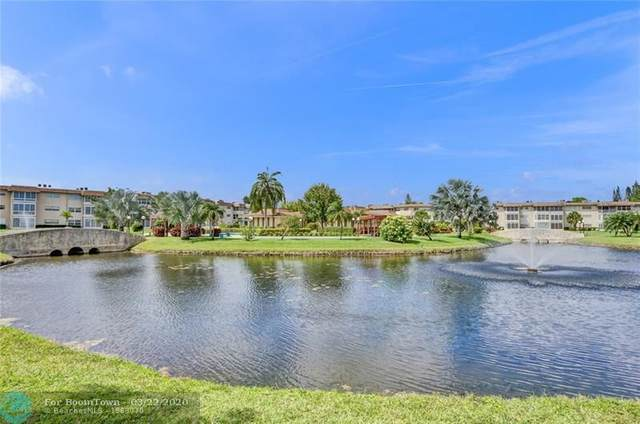 4801 NW 34th St #409, Lauderdale Lakes, FL 33319 (MLS #F10222951) :: Castelli Real Estate Services