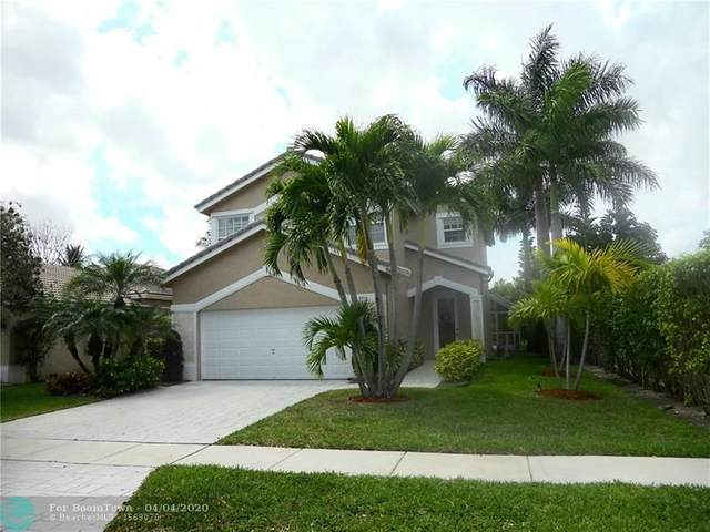 7713 NW 70th Ave, Parkland, FL 33067 (MLS #F10224516) :: The O'Flaherty Team