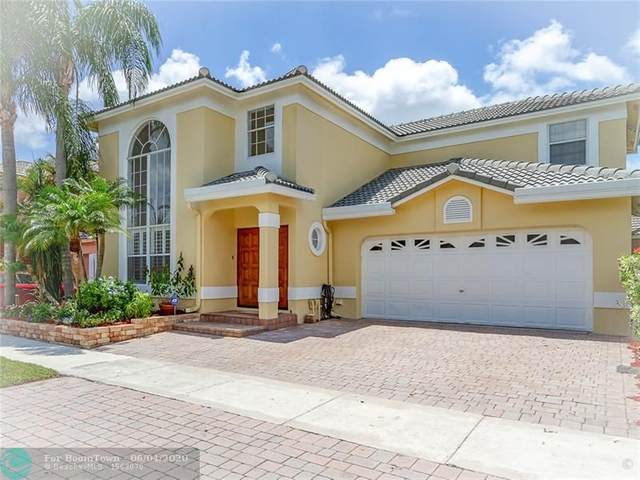4284 NW 56th Dr, Coconut Creek, FL 33073 (MLS #F10231810) :: THE BANNON GROUP at RE/MAX CONSULTANTS REALTY I