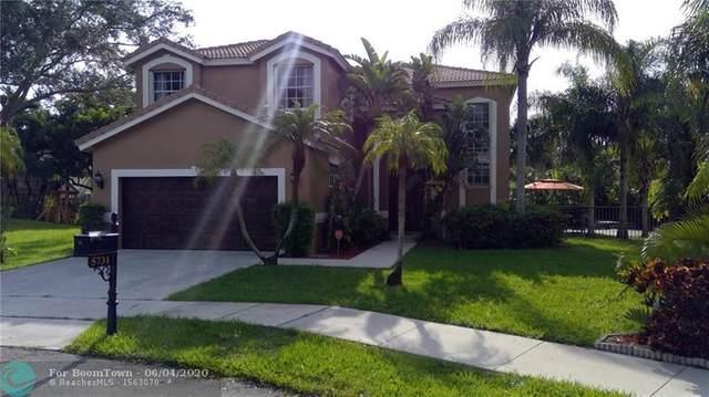 5731 NW 61st Pl, Parkland, FL 33067 (MLS #F10232395) :: The Paiz Group