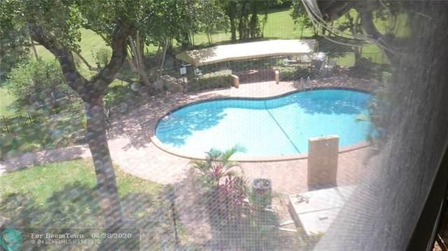 6060 S Falls Circle Dr #409, Lauderhill, FL 33319 (MLS #F10236099) :: Berkshire Hathaway HomeServices EWM Realty
