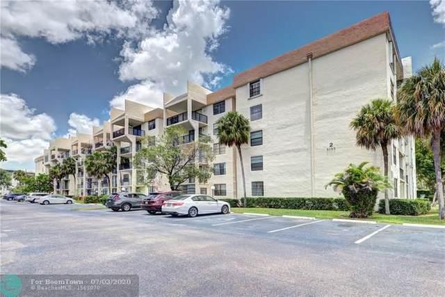 6195 Rock Island Rd #307, Tamarac, FL 33319 (MLS #F10237189) :: Berkshire Hathaway HomeServices EWM Realty