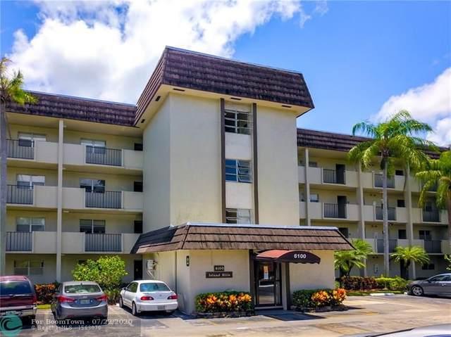 6100 NW 44th St #104, Lauderhill, FL 33319 (MLS #F10239626) :: Berkshire Hathaway HomeServices EWM Realty