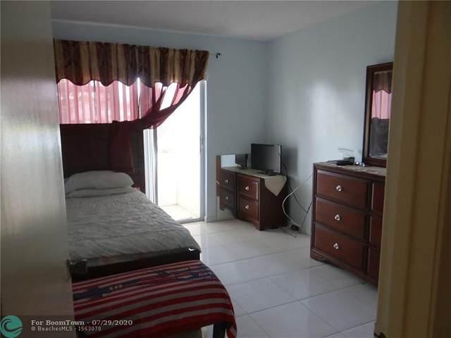 122 Lyndhurst F #122, Deerfield Beach, FL 33442 (MLS #F10241131) :: Berkshire Hathaway HomeServices EWM Realty