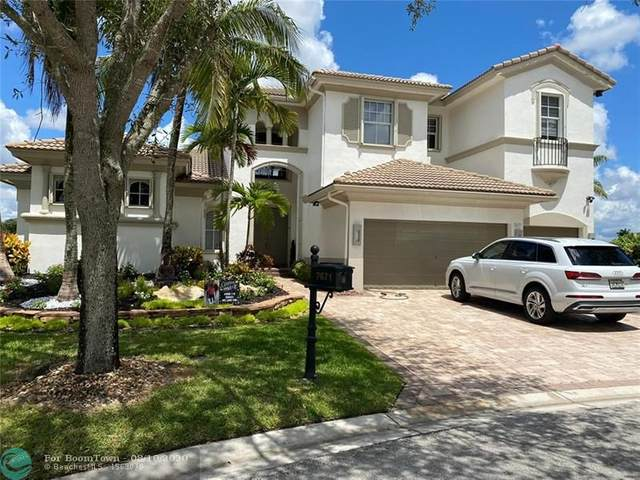 7671 NW 116th Ln, Parkland, FL 33076 (MLS #F10243315) :: United Realty Group