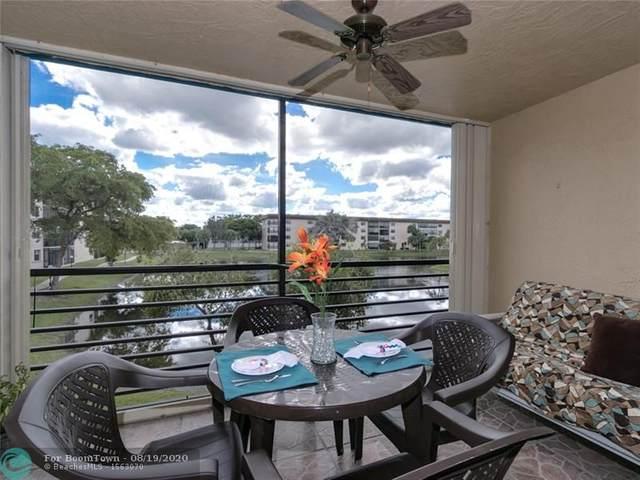 4930 E Sabal Palm Blvd #210, Tamarac, FL 33319 (MLS #F10244137) :: Berkshire Hathaway HomeServices EWM Realty