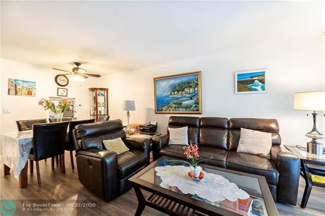 6070 NW 64th Ave #203, Tamarac, FL 33319 (MLS #F10245166) :: Berkshire Hathaway HomeServices EWM Realty
