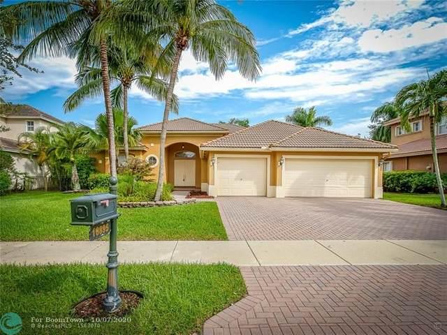 10895 NW 71st Ct, Parkland, FL 33076 (MLS #F10252265) :: Berkshire Hathaway HomeServices EWM Realty