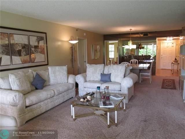 3520 Oaks Way #208, Pompano Beach, FL 33069 (MLS #F10255317) :: Berkshire Hathaway HomeServices EWM Realty