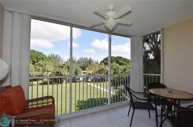 2650 S Course Dr #407, Pompano Beach, FL 33069 (MLS #F10257077) :: Berkshire Hathaway HomeServices EWM Realty