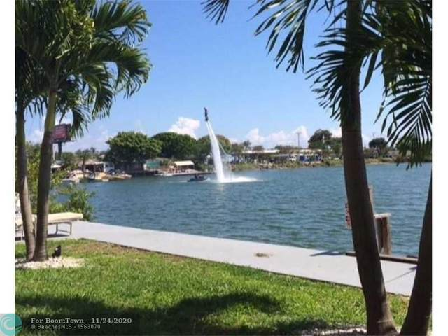 1060 Crystal Lake Dr #103, Deerfield Beach, FL 33064 (MLS #F10259511) :: Berkshire Hathaway HomeServices EWM Realty