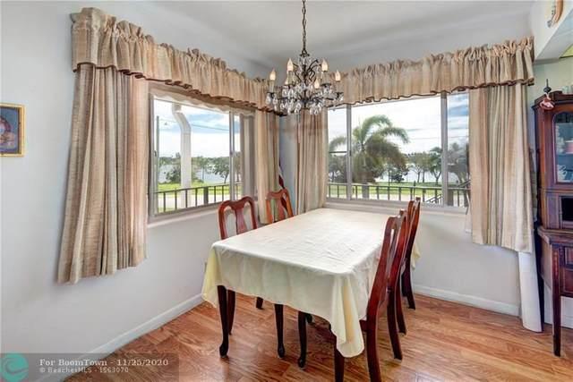 3160 Lake Osborne Dr #203, Lake Worth, FL 33461 (MLS #F10260199) :: Castelli Real Estate Services