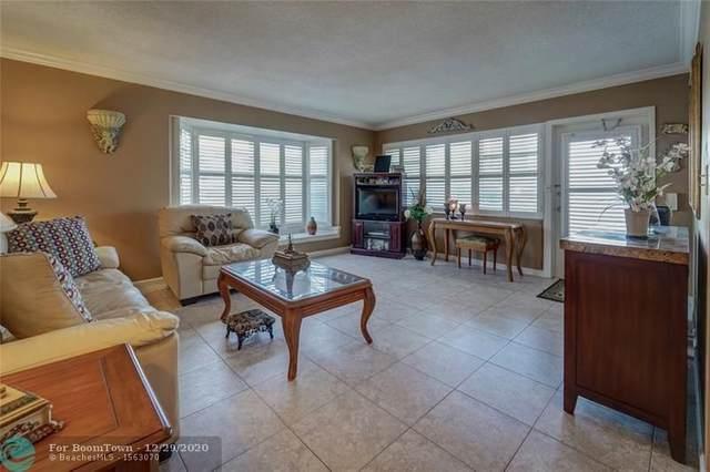 1950 NE 3rd St #14, Deerfield Beach, FL 33441 (MLS #F10264041) :: Castelli Real Estate Services
