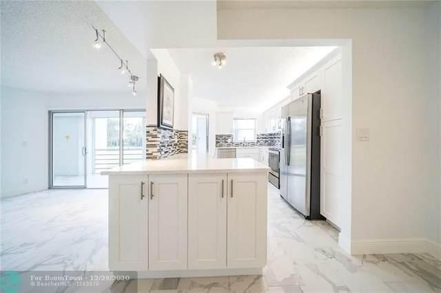 3951 Via Poinciana #214, Lake Worth, FL 33467 (MLS #F10264141) :: Berkshire Hathaway HomeServices EWM Realty