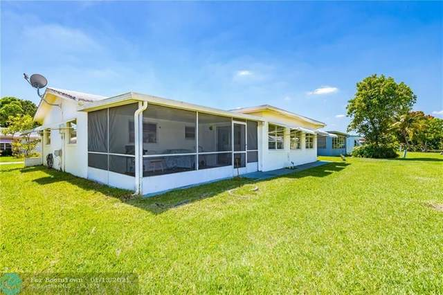 5716 NW 85th Ave, Tamarac, FL 33321 (MLS #F10266400) :: THE BANNON GROUP at RE/MAX CONSULTANTS REALTY I
