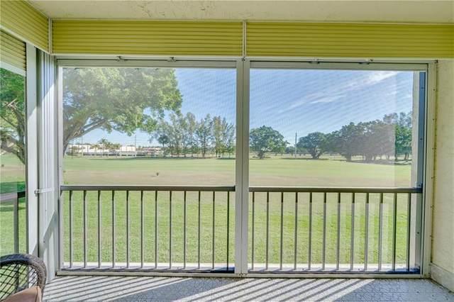 9300 N Hollybrook Lake #202, Pembroke Pines, FL 33025 (MLS #F10271130) :: Berkshire Hathaway HomeServices EWM Realty