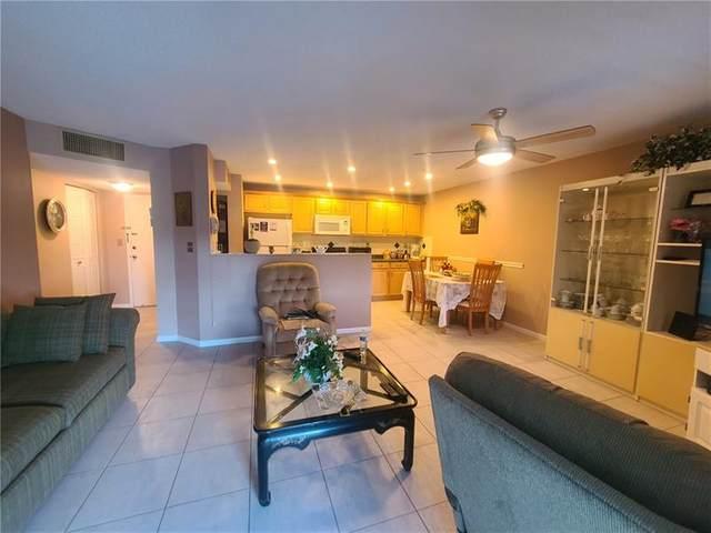 5190 E Sabal Palm Blvd #306, Tamarac, FL 33319 (MLS #F10271231) :: Berkshire Hathaway HomeServices EWM Realty