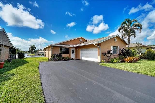 7605 NW 88th Way, Tamarac, FL 33321 (MLS #F10271813) :: Berkshire Hathaway HomeServices EWM Realty