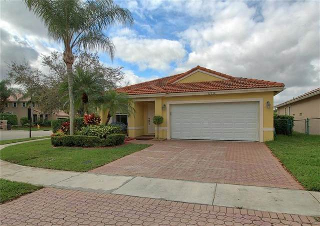 12334 NW 56th Ct, Coral Springs, FL 33076 (MLS #F10271914) :: Castelli Real Estate Services
