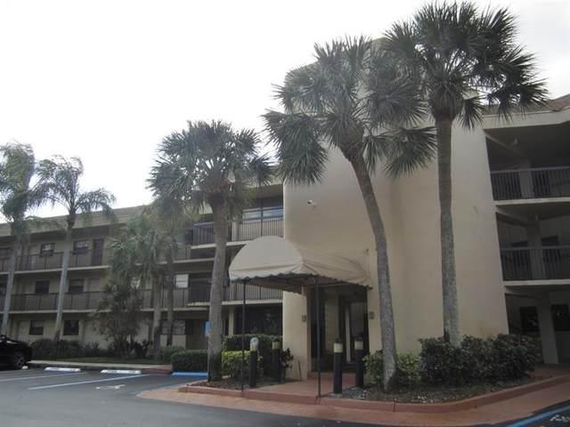 7737 NW 79th Ave #206, Tamarac, FL 33321 (MLS #F10272037) :: Berkshire Hathaway HomeServices EWM Realty