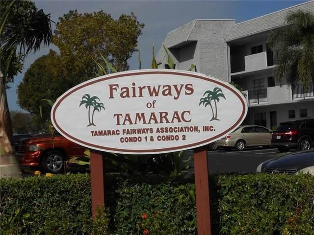 8205 NW 61st St B215, Tamarac, FL 33321 (MLS #F10272311) :: Castelli Real Estate Services
