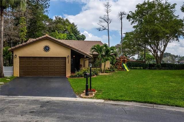 1501 Riverwood Ln, Coral Springs, FL 33071 (MLS #F10272585) :: Berkshire Hathaway HomeServices EWM Realty