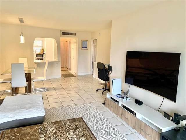1780 NE 191st St 104-2, Miami, FL 33179 (MLS #F10272738) :: Berkshire Hathaway HomeServices EWM Realty
