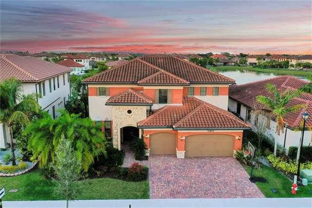 11613 NW 81st Pl, Parkland, FL 33076 (MLS #F10273351) :: Castelli Real Estate Services