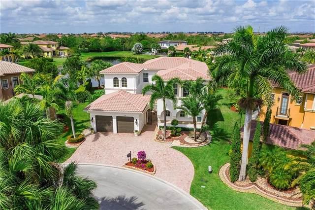 11076 NW 79th Pl, Parkland, FL 33076 (MLS #F10273658) :: Berkshire Hathaway HomeServices EWM Realty