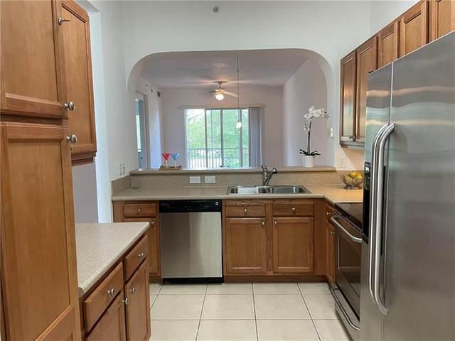 3600 Oaks Clubhouse Dr #204, Pompano Beach, FL 33069 (#F10273730) :: Treasure Property Group