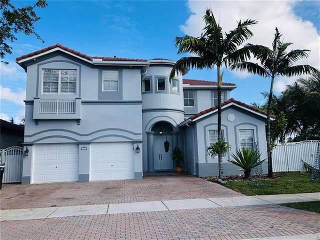 17801 NW 87th Ct, Miami Lakes, FL 33018 (MLS #F10273914) :: Berkshire Hathaway HomeServices EWM Realty