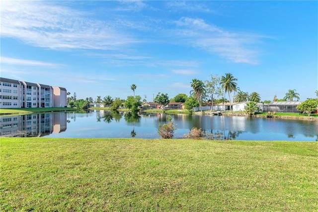 2711 NW 104th Ave #103, Sunrise, FL 33322 (MLS #F10277114) :: Berkshire Hathaway HomeServices EWM Realty