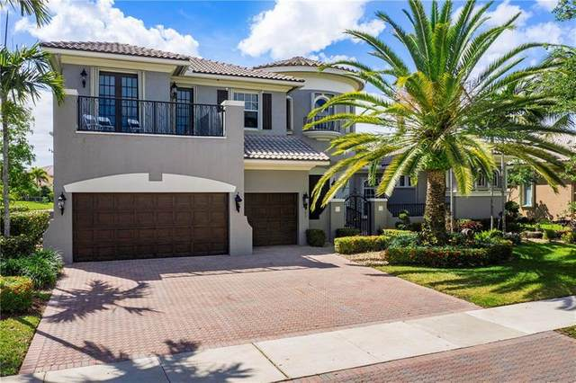 6863 NW 116th Ave, Parkland, FL 33076 (MLS #F10277628) :: The Paiz Group