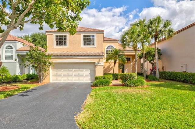 6375 NW 77th Pl, Parkland, FL 33067 (MLS #F10278215) :: Patty Accorto Team
