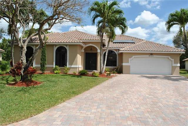 9751 NW 47th Dr, Coral Springs, FL 33076 (MLS #F10278797) :: The Jack Coden Group