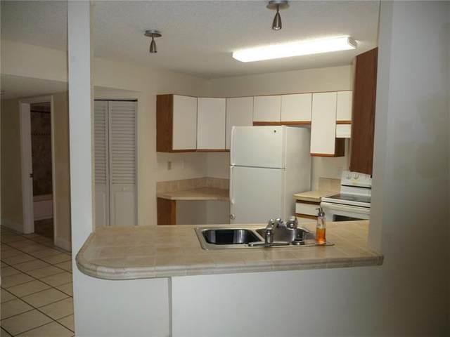 4035 W Mcnab Rd F101, Pompano Beach, FL 33069 (#F10280079) :: Posh Properties