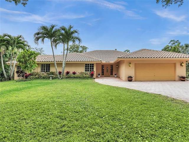 6157 NW 63rd Way, Parkland, FL 33067 (MLS #F10280346) :: The Paiz Group