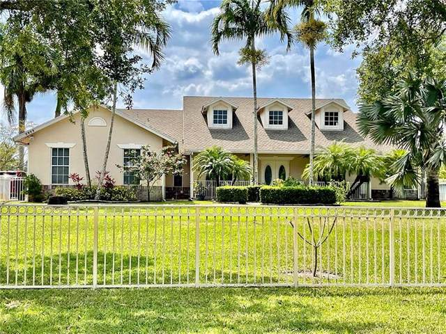5833 NW 75th Way, Parkland, FL 33067 (MLS #F10280704) :: Berkshire Hathaway HomeServices EWM Realty
