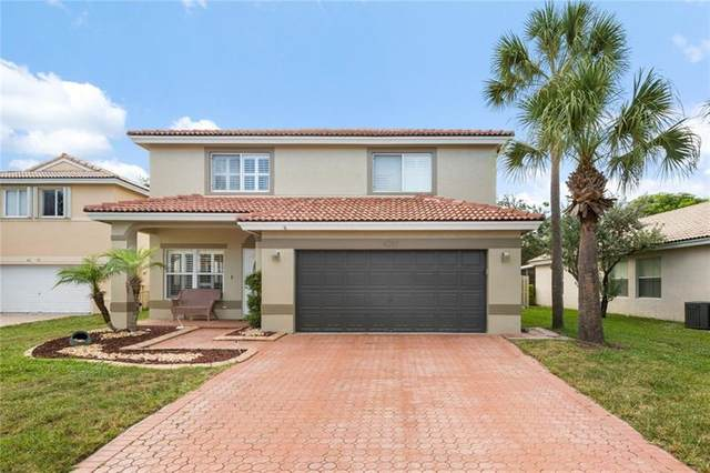 6281 NW 41st Terrace, Coconut Creek, FL 33073 (MLS #F10281074) :: United Realty Group