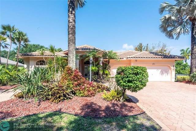 6937 NW 107th Ter, Parkland, FL 33076 (MLS #F10282183) :: The Jack Coden Group