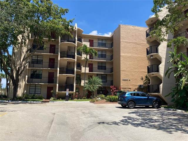 3590 Blue Lake Dr #303, Pompano Beach, FL 33064 (MLS #F10282644) :: Berkshire Hathaway HomeServices EWM Realty
