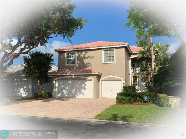 7601 NW 59th Way, Parkland, FL 33067 (MLS #F10283145) :: Patty Accorto Team