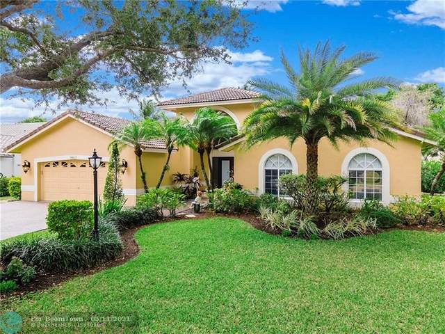 9960 NW 58th Ct, Parkland, FL 33076 (MLS #F10283986) :: GK Realty Group LLC