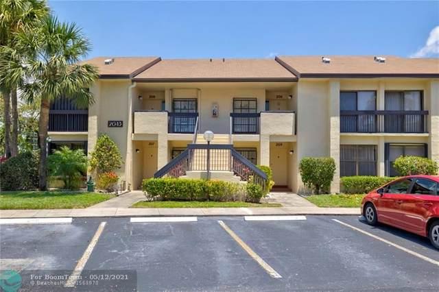 2043 SW 15th St #207, Deerfield Beach, FL 33442 (MLS #F10284137) :: Berkshire Hathaway HomeServices EWM Realty