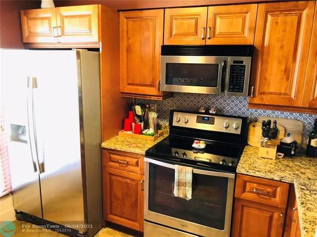 2700 S Oakland Forest Dr #202, Oakland Park, FL 33309 (MLS #F10287341) :: Berkshire Hathaway HomeServices EWM Realty