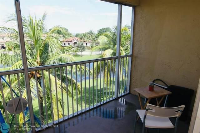 5654 Rock Island Rd #234, Tamarac, FL 33319 (MLS #F10287384) :: Berkshire Hathaway HomeServices EWM Realty